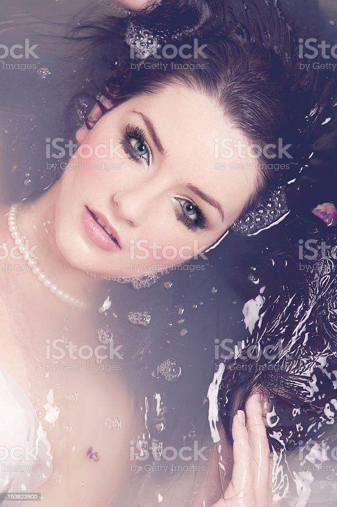 Beautiful woman in water royalty-free stock photo