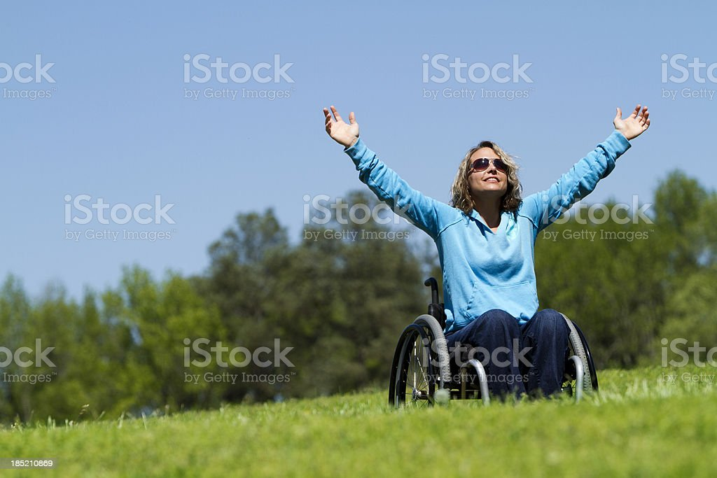 Beautiful Woman in Wheelchair Celebrating Life! royalty-free stock photo