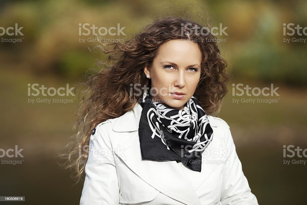Beautiful woman in white against autumn nature background royalty-free stock photo