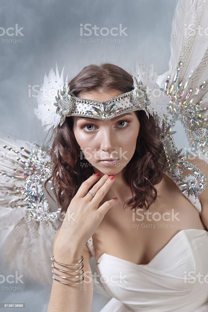 Beautiful woman in white dress with angel wings stock photo