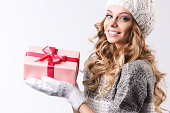 Beautiful woman in winter clothes with christmas presents.