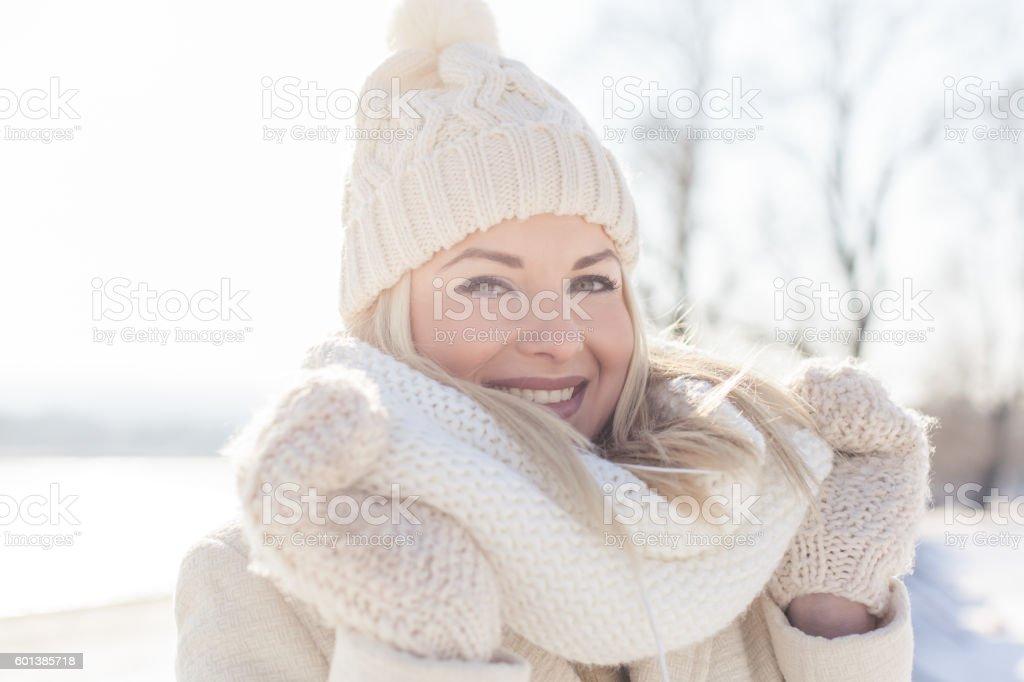 Beautiful woman in winter clothing stock photo
