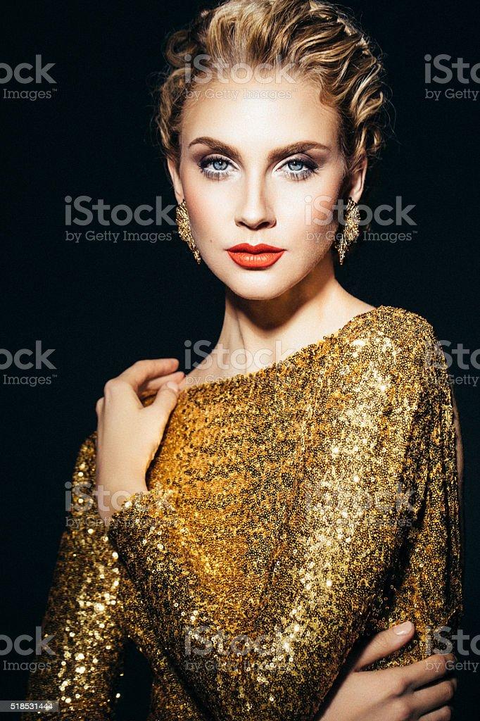 Beautiful woman in yellow dress stock photo