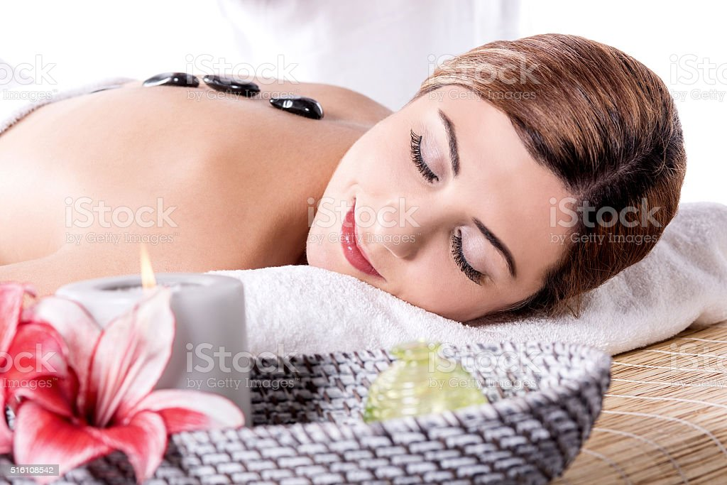 Beautiful woman is a stone therapy stock photo