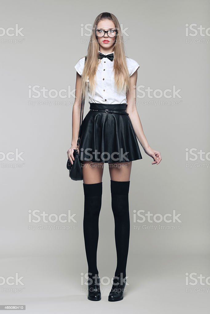 Beautiful woman is in fashion style in black mini skirt stock photo