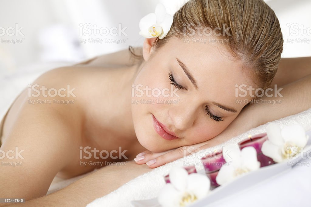 Beautiful woman is relaxing at spa centre stock photo