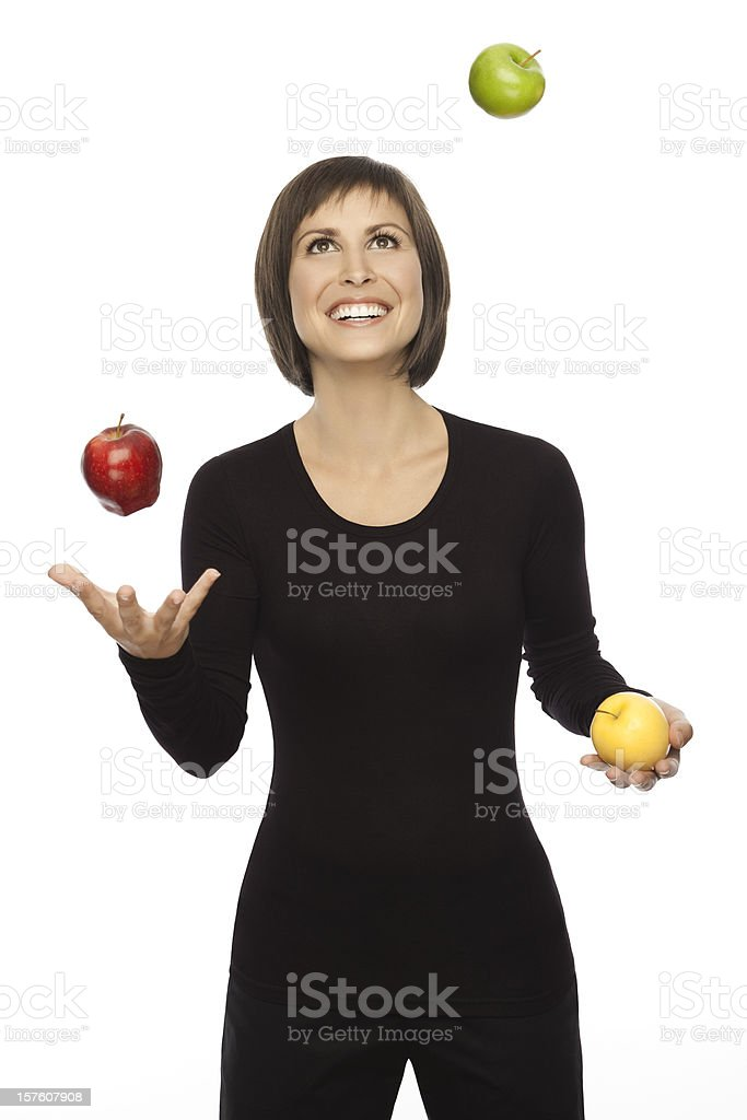Beautiful woman Juggling With Three Apples stock photo