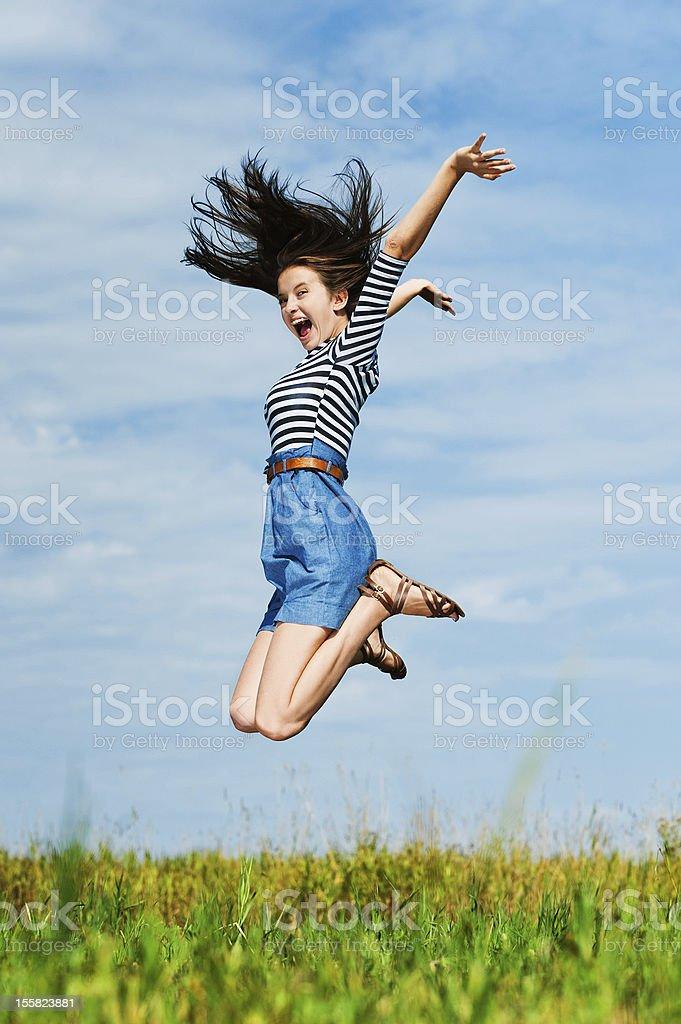 beautiful woman jumping high royalty-free stock photo