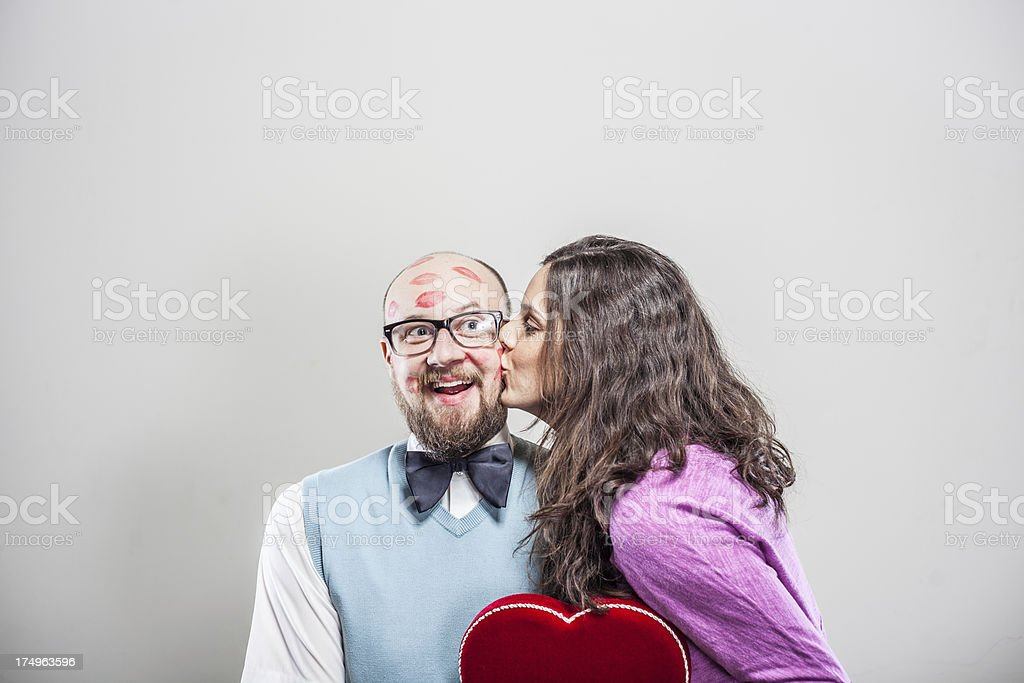 Beautiful Woman Kissing a Nerd on Valentine's Day royalty-free stock photo