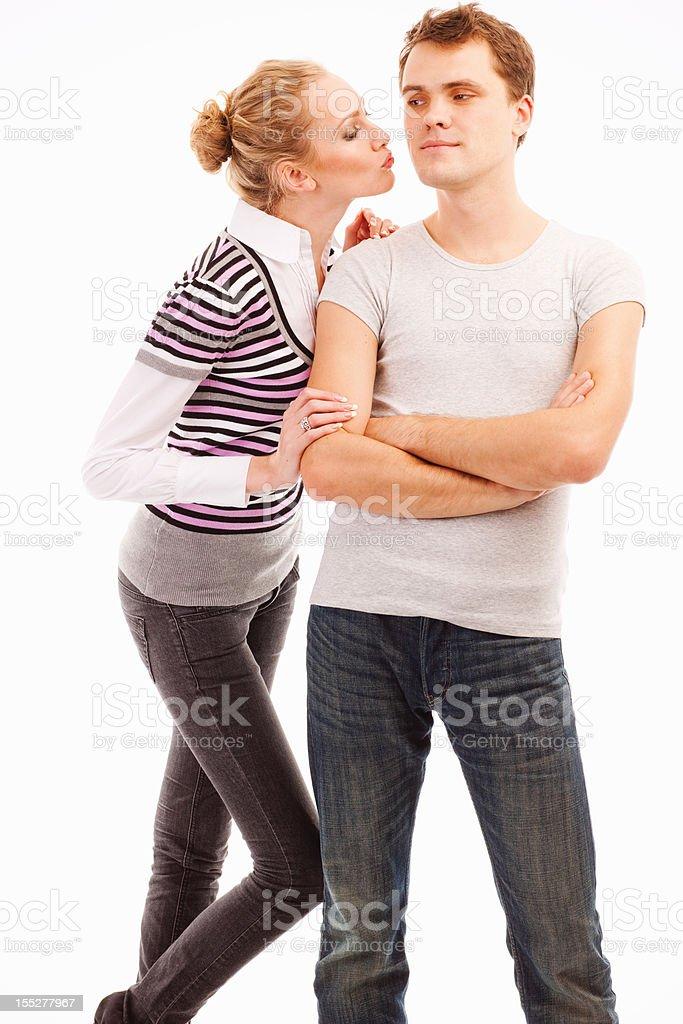 Beautiful woman kissing her boyfriend stock photo