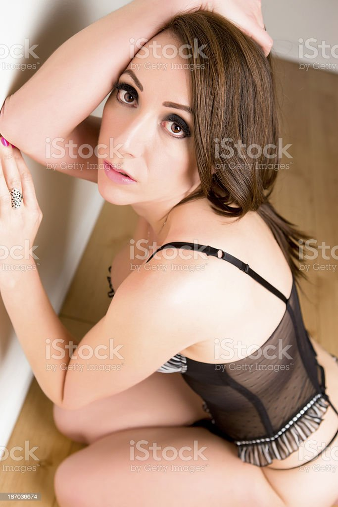 Beautiful woman kneeling on floor royalty-free stock photo