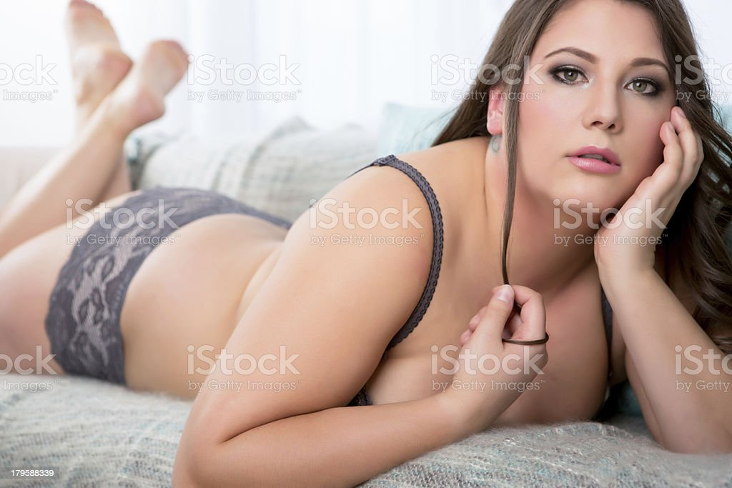 Beautiful woman laying on couch stock photo