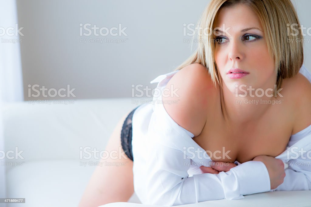 Beautiful woman laying on couch royalty-free stock photo