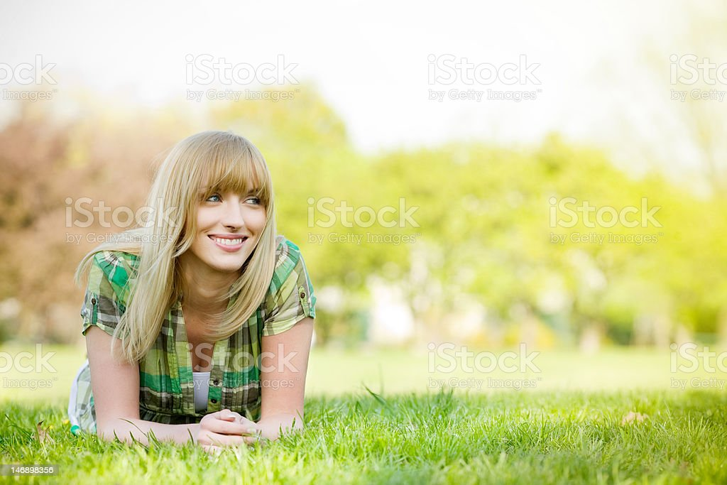 Beautiful woman laying on grass royalty-free stock photo