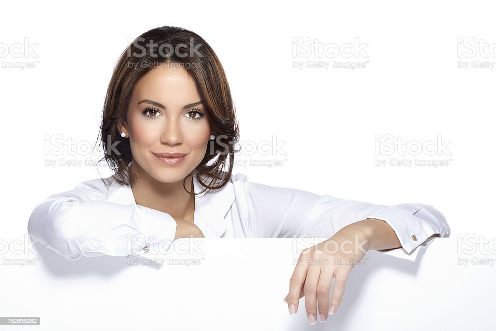 Beautiful woman leaned on a white billboard royalty-free stock photo