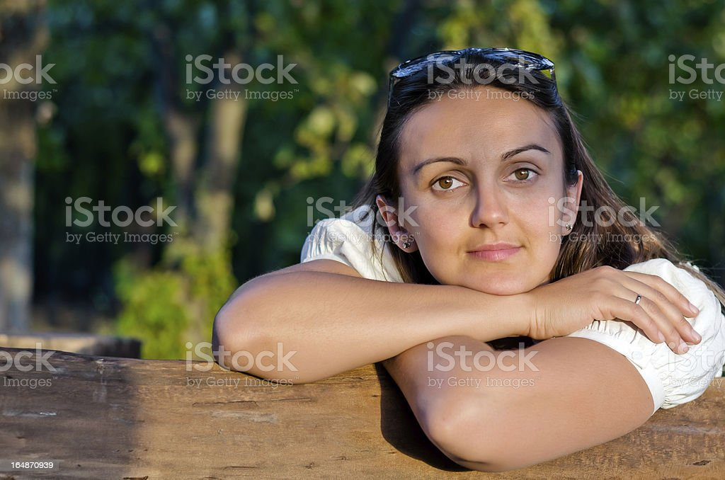 Beautiful woman leaning on a fence royalty-free stock photo