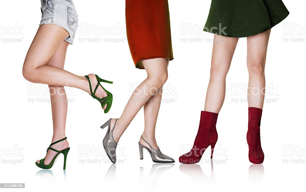 Beautiful woman legs with italian color shoes and dresses. stock photo
