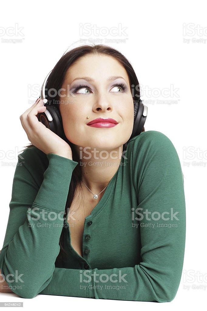 Beautiful woman listening music in headphones royalty-free stock photo