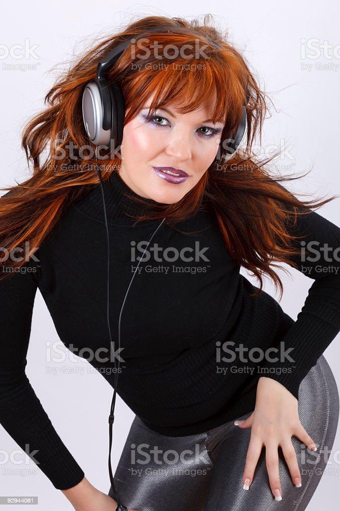 Beautiful Woman Listening to Music stock photo