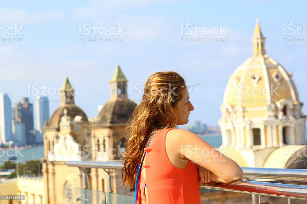 Beautiful woman looking at Church of St Peter in Cartagena stock photo