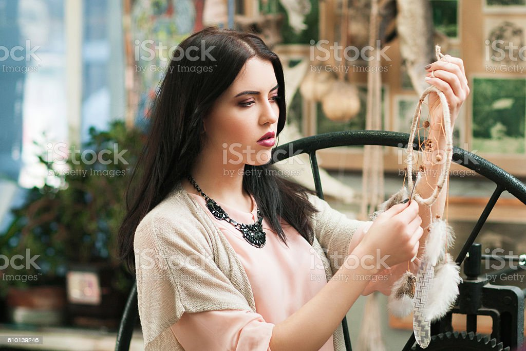 Beautiful woman looking at new dream catcher stock photo