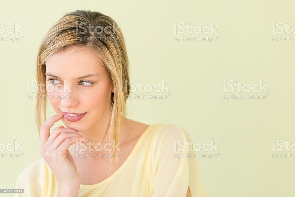 Beautiful Woman Looking Away With Hand On Chin royalty-free stock photo