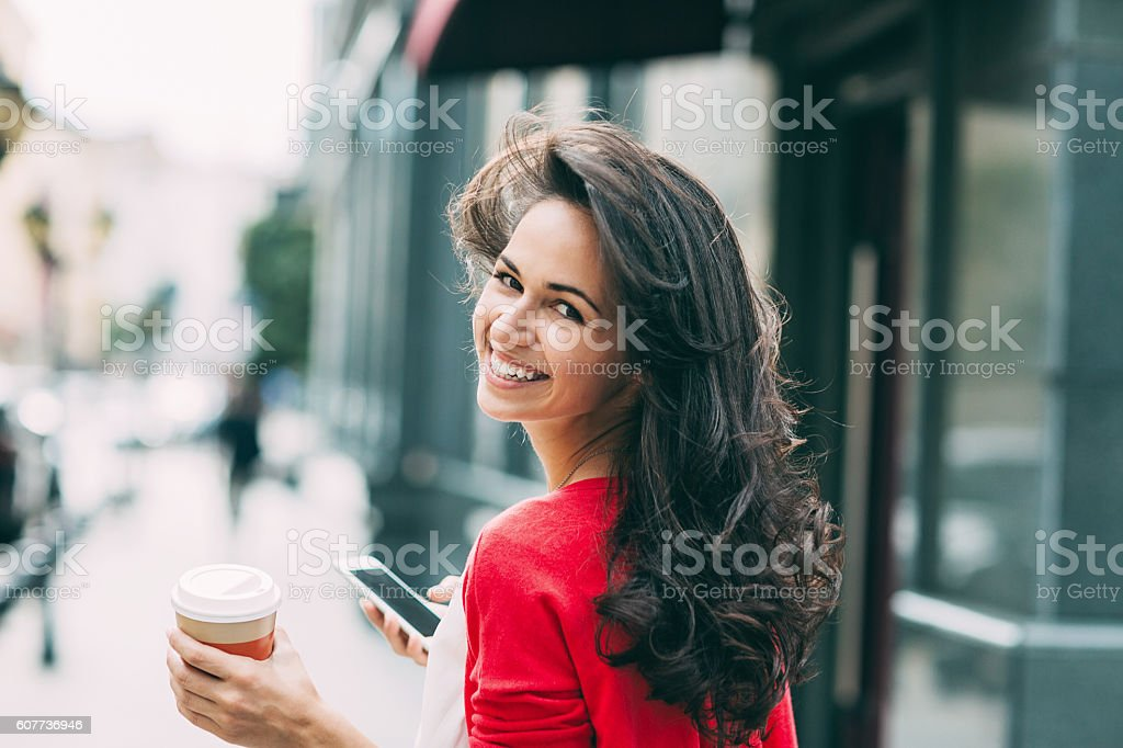 Beautiful woman looking back over her shoulder stock photo
