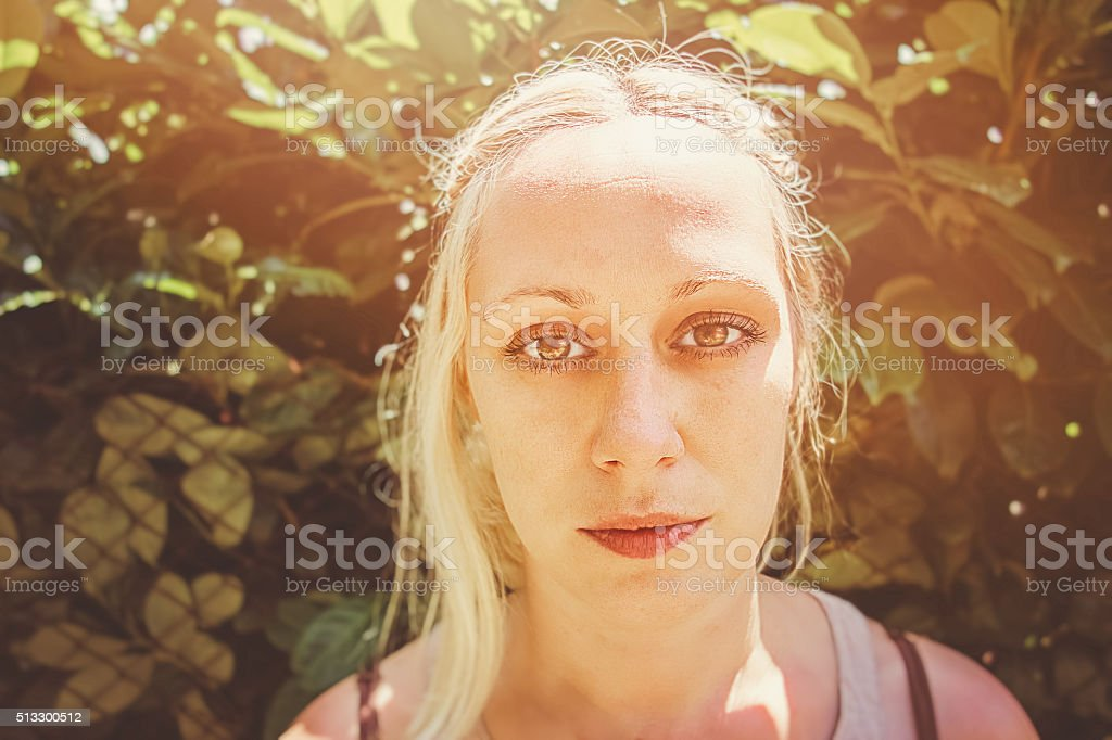 Beautiful woman looking into the camera stock photo