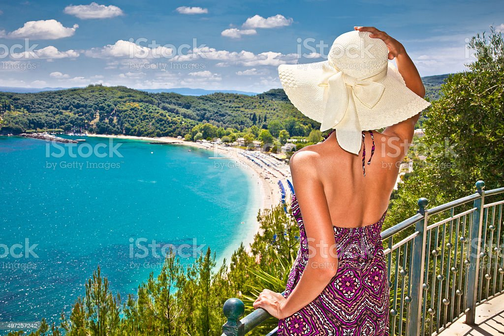 Beautiful woman looking on Valtos beach near Parga, Greece. stock photo
