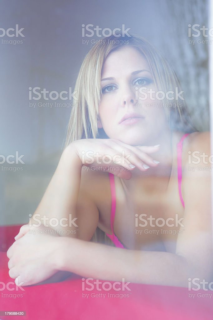 Beautiful woman looking out the window royalty-free stock photo