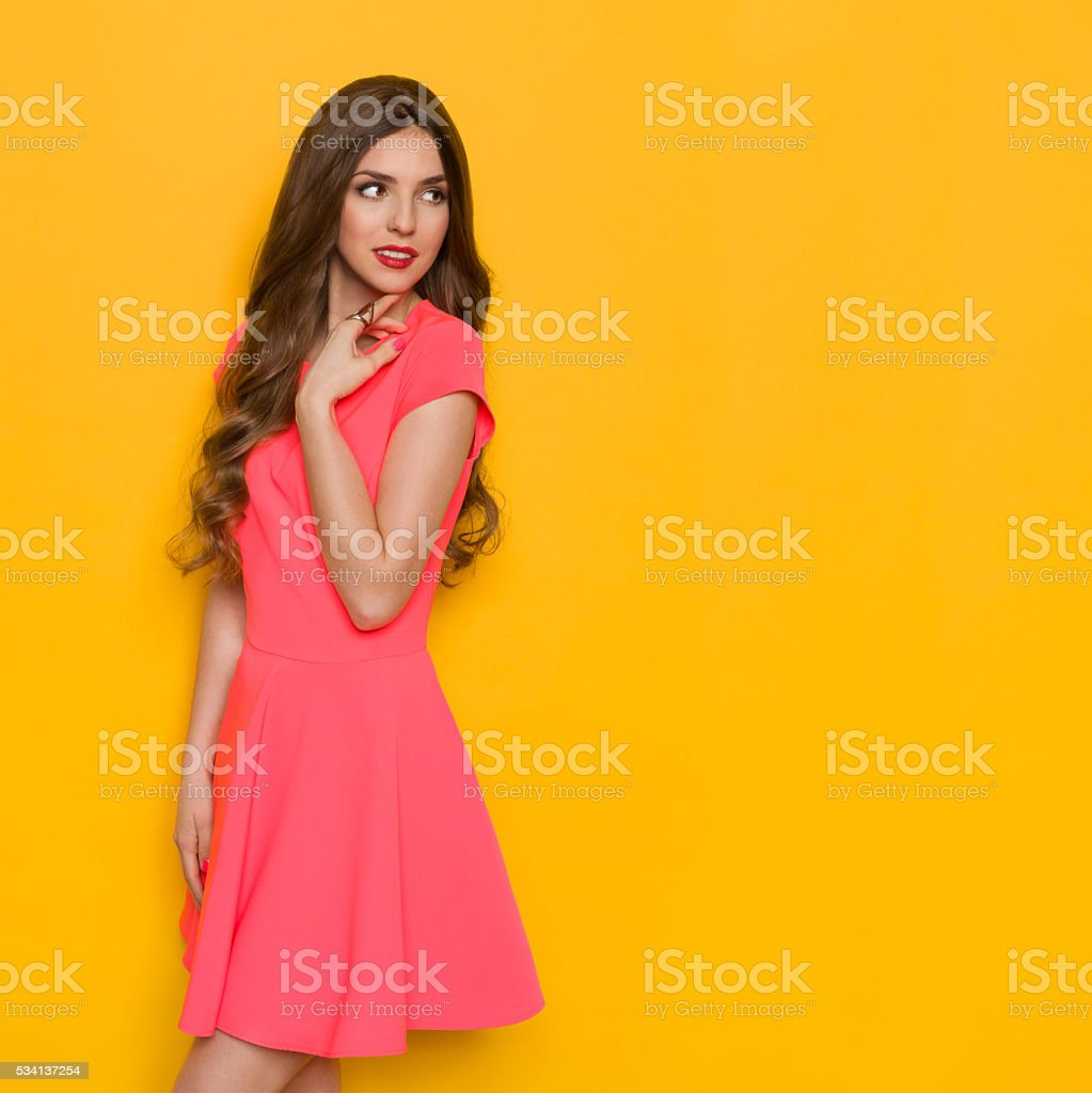 Beautiful Woman Looking Over Her Shoulder stock photo