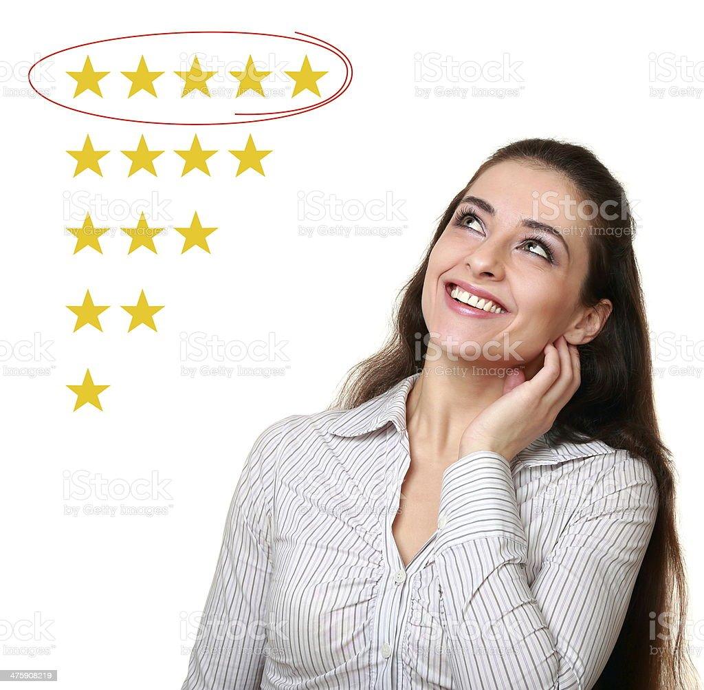 Beautiful woman looking up and choose five stars rating stock photo