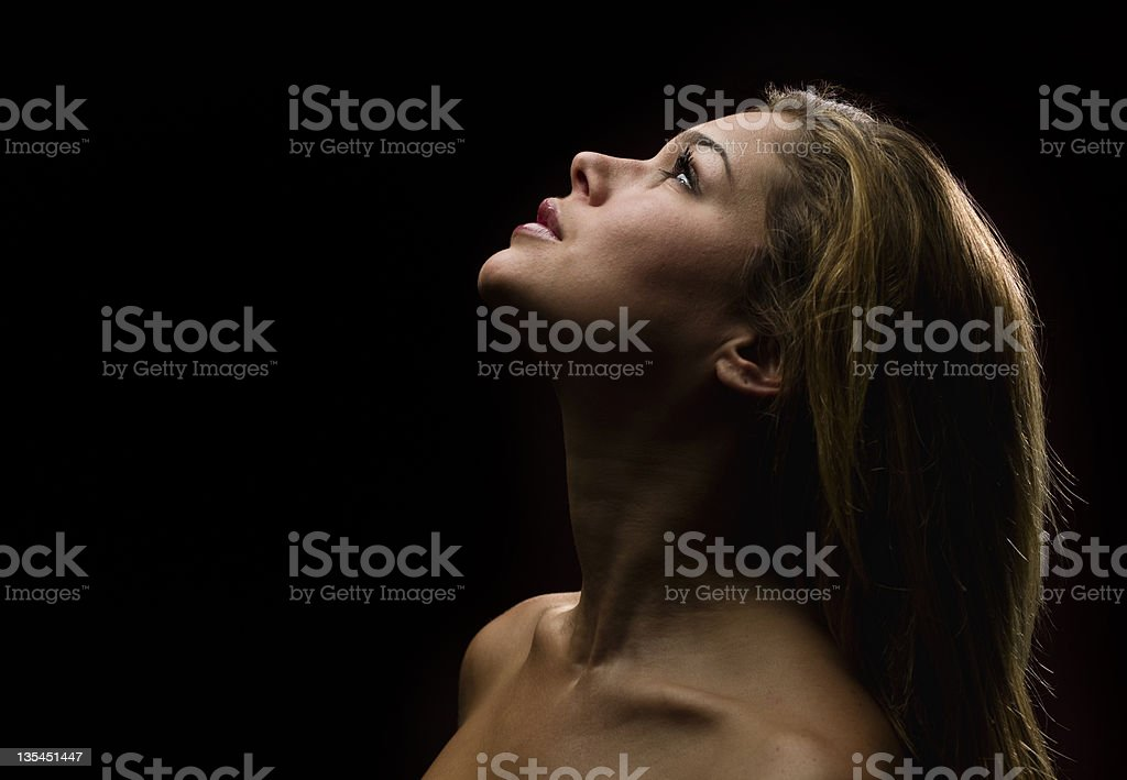 Beautiful woman looking up royalty-free stock photo