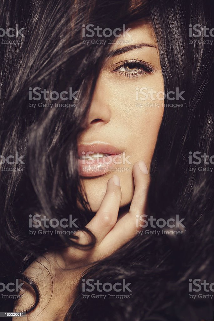 Beautiful woman looks through her hairs royalty-free stock photo