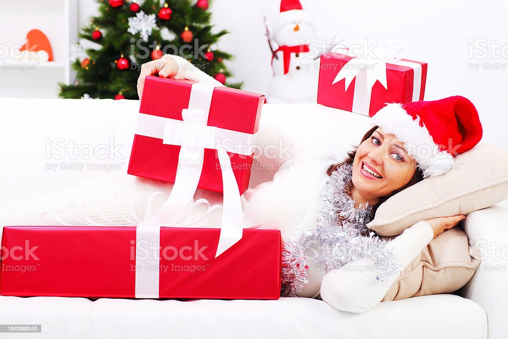 Beautiful woman lying and resting on New Years day. royalty-free stock photo