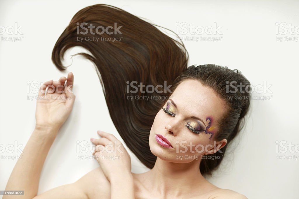 beautiful woman lying on floor royalty-free stock photo