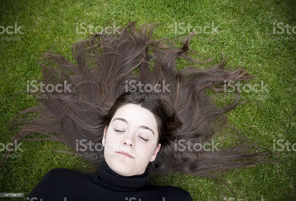 Beautiful Woman Lying on Grass royalty-free stock photo