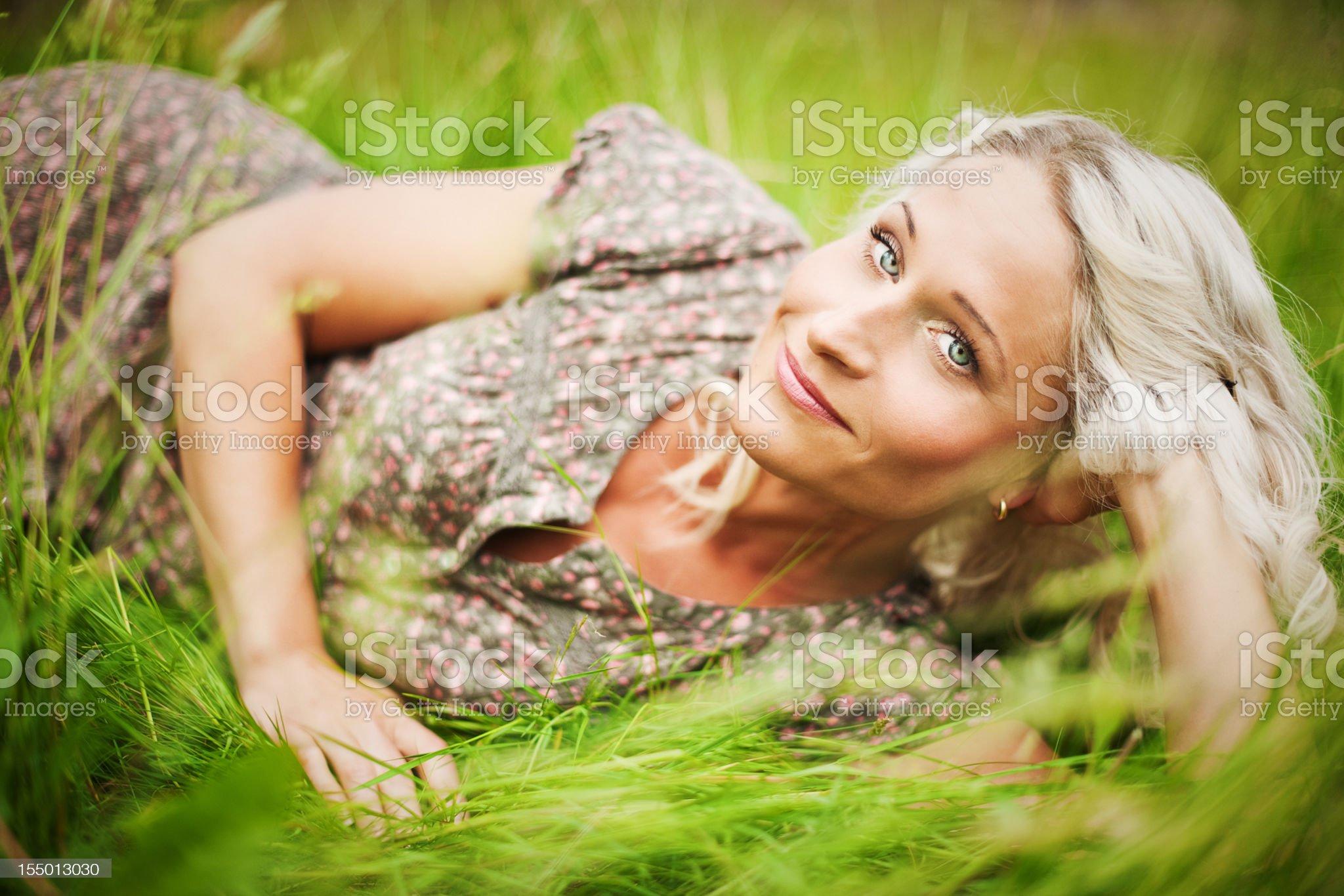 Beautiful woman lying on grass royalty-free stock photo