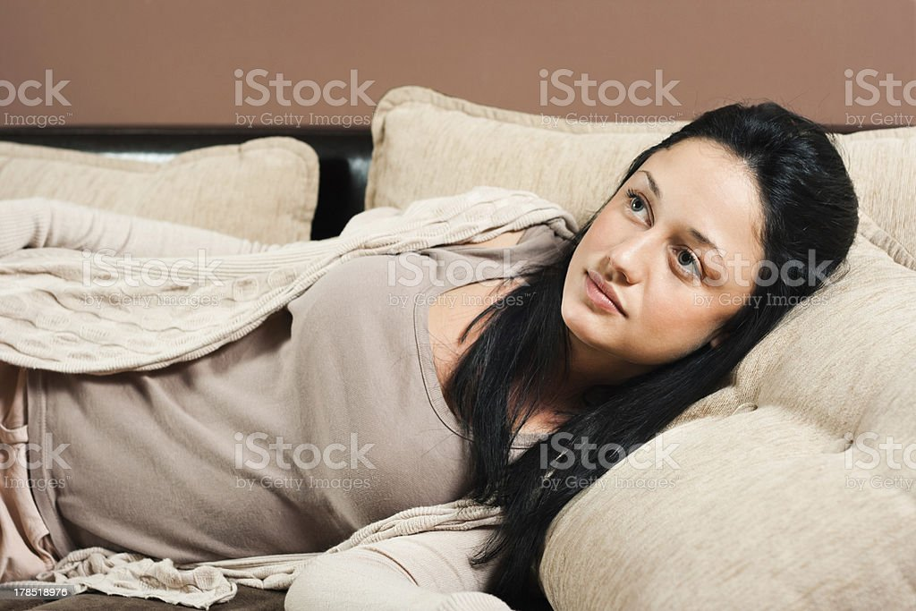 Beautiful woman lying on sofa royalty-free stock photo