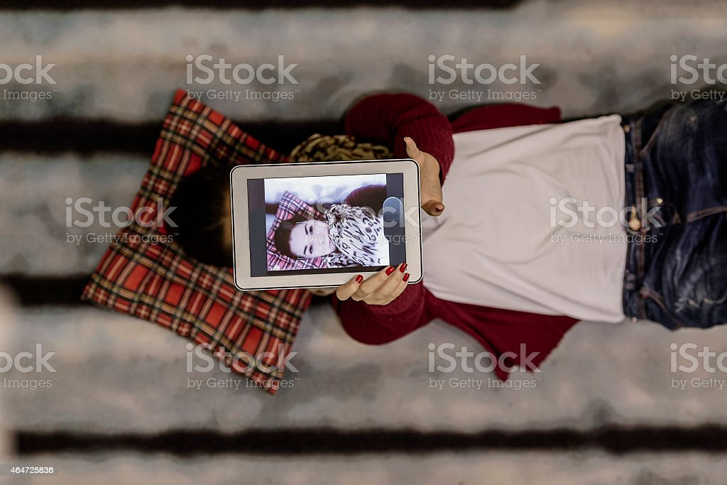 Beautiful  woman making a self portrait in bed stock photo