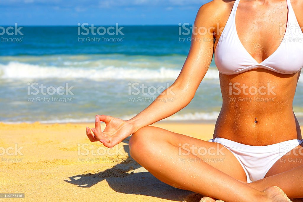 Beautiful woman meditating by the sea royalty-free stock photo