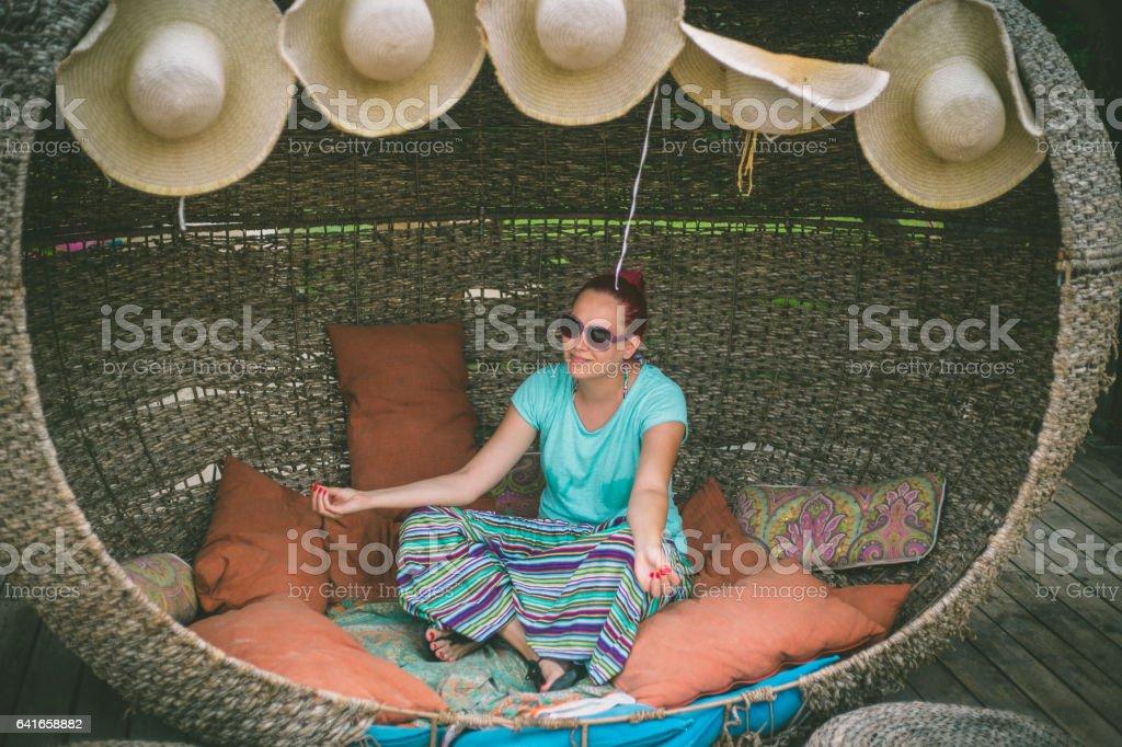 Beautiful woman meditating in a garden chair stock photo