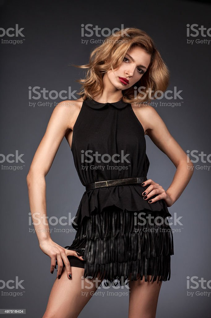 Beautiful woman model in elegance pose on studio gray background stock photo