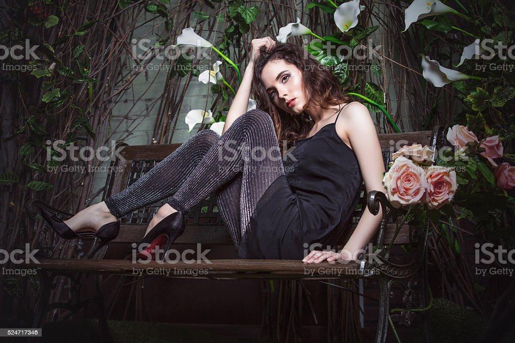 Beautiful woman model in the night garden in stylish stock photo