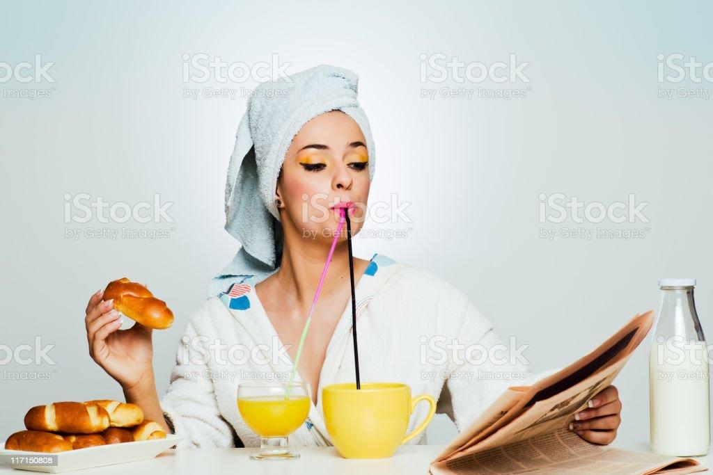 Beautiful woman multiple-tasking breakfast. stock photo