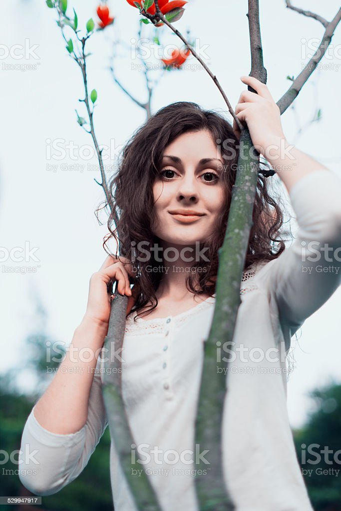 Beautiful woman near magnolia tree royalty-free stock photo