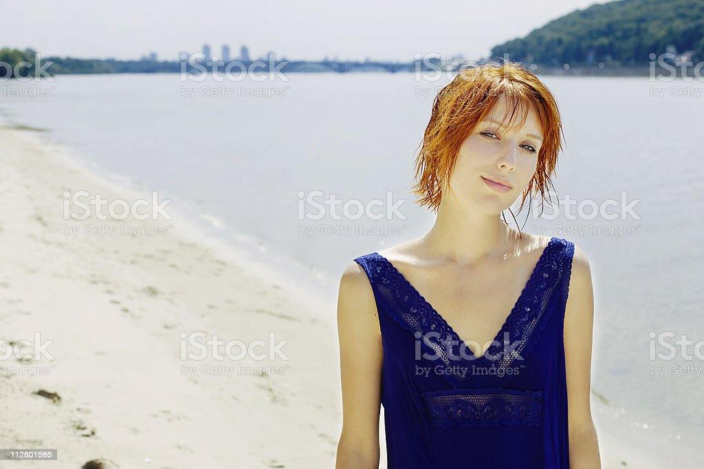 Beautiful woman near river stock photo