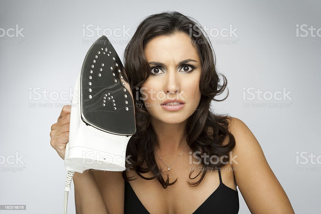 Beautiful Woman Nearly In Hysterics Holding An Iron royalty-free stock photo