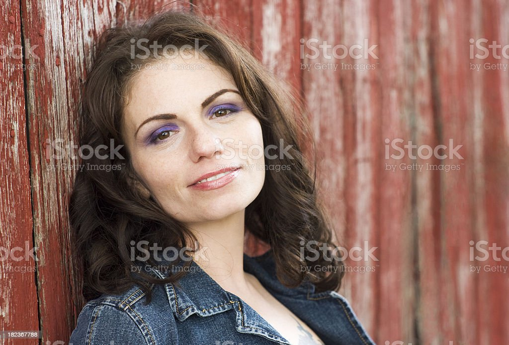 Beautiful woman next to old barn royalty-free stock photo