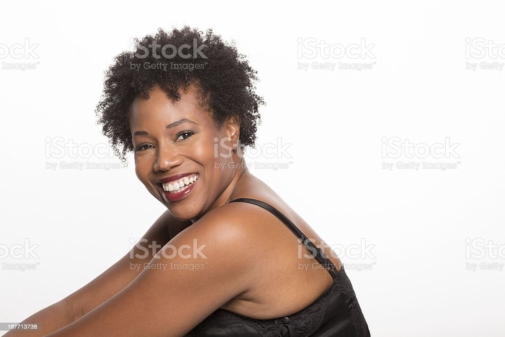 Beautiful woman of african decent smiling stock photo